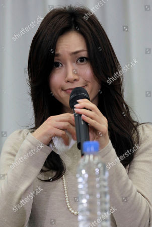 Stock Photo of Noriko Sakai Japanese singer and actress Noriko Sakai reacts during her news conference in Tokyo as she came back to the entertainment industry, a day after she finished her three years on parole. Sakai, once hugely popular in Asia, was convicted of drug use in 2009
