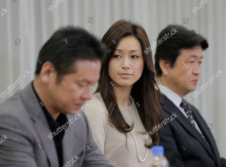 Stock Picture of Noriko Sakai, Masayuki Imai Japanese singer and actress Noriko Sakai, center, accompanied by actor Masayuki Imai, left, attends a news conference of their new stage titled 'Rhapsody of Azure Sky' in Tokyo as she came back to the entertainment industry, a day after she finished her three years on parole. Sakai, once hugely popular in Asia, was convicted of drug use in 2009