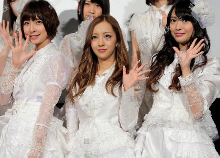 """Stock Photo of Mariko Shinoda, Tomomi Itano, Rie Kitahara Members of Japanese girls pop gourp AKB48, from left, Mariko Shinoda, Tomomi Itano and Rie Hitahara, pose for photographers at the opening premiere of their new film """"Documentary of AKB48 No Flower Without Rain,"""" in Tokyo, . The film was released in the day in Japan"""