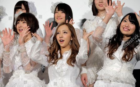 """Stock Picture of Mariko Shinoda, Tomomi Itano, Rie Kitahara Members of Japanese girls pop gourp AKB48, from left, Mariko Shinoda, Tomomi Itano and Rie Hitahara, pose for photographers at the opening premiere of their new film """"Documentary of AKB48 No Flower Without Rain,"""" in Tokyo, . The film was released in the day in Japan"""