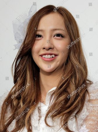 """Tomomi Itano Tomomi Itano, a member of Japanese girls pop gourp AKB48, poses for photographers at the opening premiere of their new film """"Documentary of AKB48 No Flower Without Rain,"""" in Tokyo"""