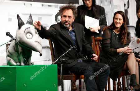 "Tim Burton, Allison Abbate Film director Tim Burton touches a replica of Sparky, a character from his film ""Frankenweenie,"" as producer Allison Abbate smiles during a press conference in Tokyo, . ""Frankenweenie"" is a stop-motion animated film, filmed in black and white and rendered in 3D"