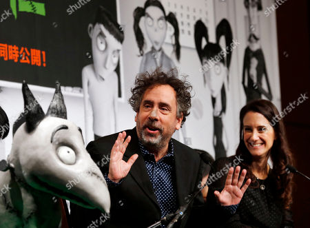 "Tim Burton, Allison Abbate Film director Tim Burton speaks at a press conference for his Disney film ""Frankenweenie"" as producer Allison Abbate smiles in Tokyo, . ""Frankenweenie"" is a stop-motion animated film, filmed in black and white and rendered in 3D"