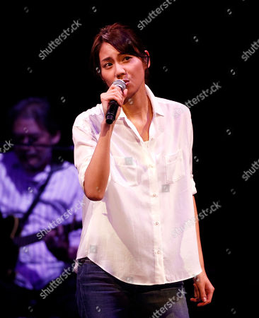 Stock Picture of Nao Matsushita Japanese actress Nao Matsushita sings a song during the Dream Power John Lennon Super Live concert at the Nippon Budokan in Tokyo