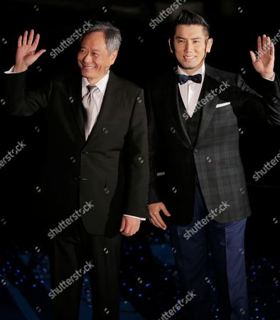 """Ang Lee, Masahiro Motoki Director Ang Lee, left, poses for photographers with Japanese actor Masahiro Motoki during the Japan premiere of Lee's 3D film """"Life of Pi,"""" in Tokyo, . The film will be released in Japan on Jan. 25"""