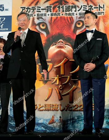 """Ang Lee, Masahiro Motoki Director Ang Lee of Taiwan, left, speaks as Japanese guest, actor Masahiro Motoki, listens during the Japan premiere of Lee's 3D film """"Life of Pi"""" in Tokyo, . The film will be released in Japan on Jan. 25"""