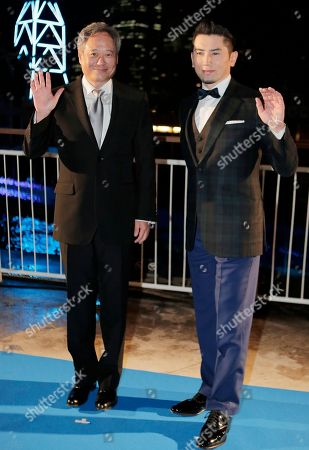 """Ang Lee, Masahiro Motoki Director Ang Lee, of Taiwan, left, poses for photographers with Japanese actor Masahiro Motoki during the Japan premiere of Lee's 3D film """"Life of Pi,"""" in Tokyo, . The film will be released in Japan on Jan. 25"""