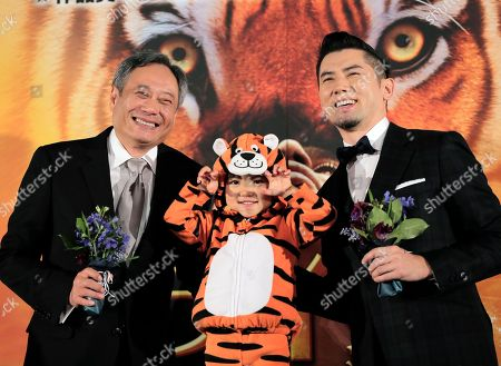 """Ang Lee, Masahiro Motoki, Shizuku Director Ang Lee, left, poses for photographers with Japanese actor Masahiro Motoki and child actress Shizuku during the Japan premiere of his 3D film """"Life of Pi,"""" in Tokyo, . The film will be released in Japan on Jan. 25"""