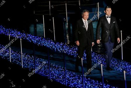 """Ang Lee, Masahiro Motoki Director Ang Lee, left, and Japanese actor Masahiro Motoki arrive at the Japan premiere of Lee's 3D film """"Life of Pi,"""" in Tokyo, . The film will be released in Japan on Jan. 25"""