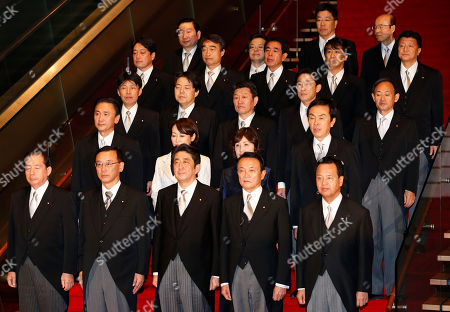 Shinzo Abe, Akihiro Ata, Sadakazu Tanigaki, Taro Aso, Akira Amari Japan's new Prime Minister Shinzo Abe, front row center, and his Cabinet members pose for a group photo following the first Cabinet meeting at the prime minister's official residence in Tokyo . Old-guard veteran Abe was voted back into office as prime minister and immediately named a new Cabinet, ending three years of liberal administrations and restoring power to his conservative, pro-big-business party that has run Japan for most of the post-World War II era. Ministers front row from left are: Land, Infrastructure, Transport and Tourism Minister Akihiro Ota, Justice Minister Sadakazu Tanigaki, Abe, Finance and Deputy Prime Minister Taro Aso and Economic Revitalization Minister Akira Amari