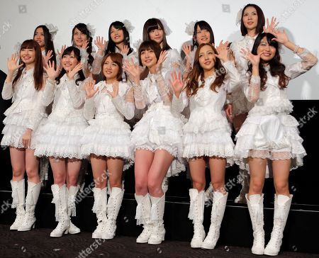 """Haruna Kojima, Mayu Watanabe, Minami Takahashi, Mariko Shinoda, Tomomi Itano, Rie Kitahara Hugely popular Japanese girl band AKB48 members, from left in first row, Haruna Kojima, Mayu Watanabe, Minami Takahashi, Mariko Shinoda, Tomomi Itano and Rie Hitahara, and others, pose for photographers at the opening premiere of their new film """"Documentary of AKB48 No Flower Without Rain"""" in Tokyo, one day after a group member shaved her head and issued a tearful videotaped apology for violating the megagroup's no-dating rule. The spectacle has sparked debate in Japan over whether the band AKB48 exerts too much control over its performers. Minami Minegishi made the video, posted on AKB48's website, after the 20-year-old was caught by a gossip magazine coming out of her boyfriend's apartment. AKB48 says it forbids its members from dating to project a clean image and signal their devotion to the group and their mostly male fans"""