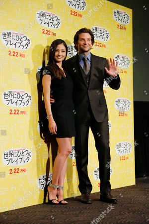 """Bradley Cooper Actor Bradley Cooper, right, and a guest Japanese actress Meisa Kuroki pose for photographers during a photo call for a new film """"Silver Linings Playbook,"""" in Tokyo"""