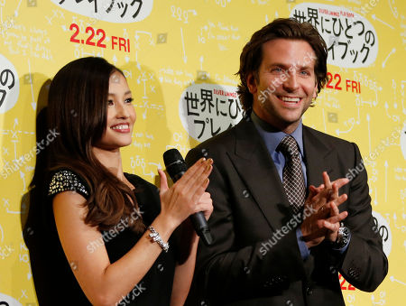"""Bradley Cooper Actor Bradley Cooper, right, and a guest Japanese actress Meisa Kuroki react during a photo call for a new film """"Silver Linings Playbook"""", in Tokyo"""