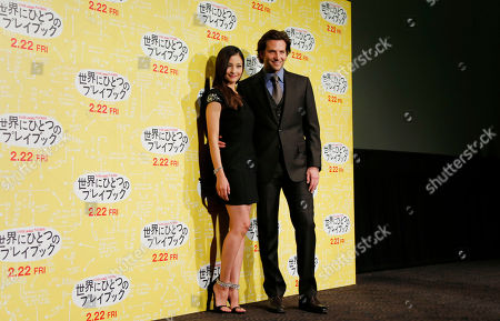 """Bradley Cooper Actor Bradley Cooper, right, and a guest Japanese actress Meisa Kuroki pose for photos during a photo call for a new film """"Silver Linings Playbook"""", in Tokyo"""
