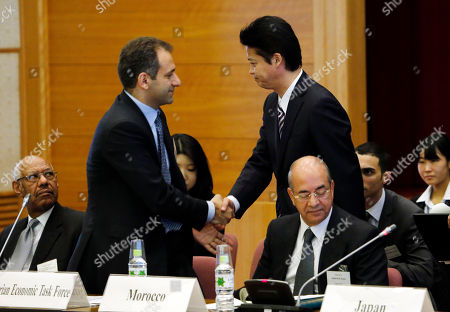 Stock Image of Oichiro Gemba, Miro Abrahim Japanese Foreign Minister Koichiro Gemba, right, shakes hands with Abrahim Miro from the Syrian Economic Task Force, during an international meeting to coordinate sanctions on the government of Syrian President Bashar Assa in Tokyo . Host Japan says Friday's talks will give participating countries a forum to review the effectiveness of sanctions already in place. They will also consider new measures to stop the violence that has erupted in Syria, resulting in a civil war that activists say has killed 36,000 people