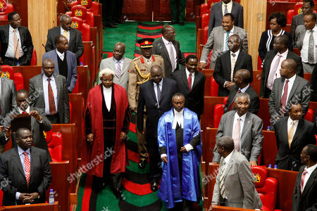 Kenya's President Mwai Kibaki, center, walks with Speaker of Parliament Kenneth Marende. left and Vice President Kalonzo Musyoka right, at Parliament, in Nairobi, Kenya, Wednesday, Dec. 19. 2012. President Mwai Kibaki on Wednesday delivered his final speech at a special sitting in Parliament, as he heads into retirement