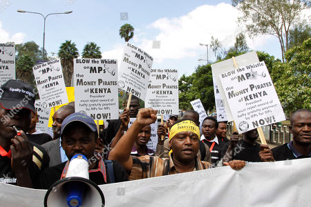 Kenyan activists march to protest outside the Parliament in downtown Nairobi, Kenya against legislation in which members of parliament gave themselves a hefty send-off package of that would also provide legislators with an armed guard, a diplomatic passport, state funerals, and access to the VIP lounge at Kenyan airports. Kenya's President Mwai Kibaki on Saturday vetoed the legislation, ordering the attorney general to redraft the law to make it compliant with the constitution