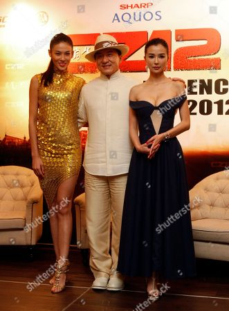 "Stock Photo of Jackie Chan, Zhang Lanxin, Yao Xintong Hong Kong movie star Jackie Chan, center, poses for photographers with Chinese actresses Zhang Lanxin, left, and Yao Xintong during a press conference to promote their new movie ""CZ12"" in Kuala Lumpur, Malaysia"