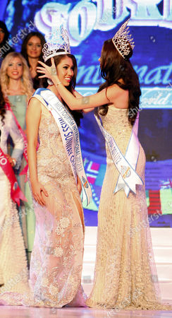 Rizzini Alexis Gomez, Aileen Gabriella Robinson Rizzini Alexis Gomez, left, of Philippines is crowned the Miss Tourism International 2012 World Final by Miss Tourism International 2011 World Final Aileen Gabriella Robinson of Malaysia during the New Year's Eve celebrations in Petaling Jaya, near Kuala Lumpur, Malaysia