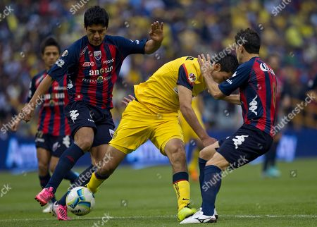 Raul Jimenez, Luis Venegas, Jose Castro America's Raul Jimenez, center, fights for the ball with Atalnte's Luis Venegas, left, and Jose Castro at a Mexican soccer league match in Mexico City