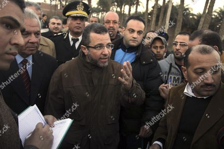 Stock Image of Egyptian Prime Minister Hesham Kandil pays a visit to the site of a train crash in Badrasheen, 40 KM south of Cairo, Egypt, . At least 19 people died and more than 100 were injured when two railroad passenger cars derailed just south of Cairo, health officials say. The accident comes less than two weeks after a new transportation minister was appointed to overhaul the rail system, and just two months after a deadly collision between a train and school bus