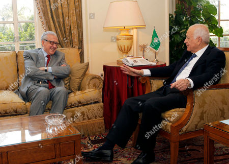 Arab League Secretary-General Nabil al-Araby, right, meets with U.N.-Arab League international Syria mediator Lakhdar Brahimi at the Arab league headquarters in Cairo, Egypt, . The fighting in Syria has settled into a bloody stalemate and shows no signs of stopping, despite several tentative proposals from both sides to find a peaceful resolution to the conflict
