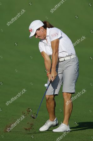 Stock Picture of Lorie Kane Lorie Kane from Canada plays a ball on the 14th hole during the third round of Dubai Ladies Masters golf tournament in Dubai, United Arab Emirates