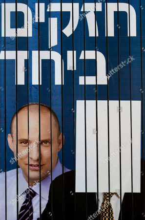 "An election campaign billboard shows Jewish Home head Naftali Bennett, left, and a covered image of Israeli Prime Minister and Likud Party leader Benjamin Netanyahu with the slogan in Hebrew, ""Strong Together,"" hangs on a main road in Tel Aviv, Israel, . Israel's National Elections Committee on Sunday imposed a 72,000 shekel (19,250 US dollars) fine on the Jewish Home party over what was said was its failure to remove an ad that shows Likud leader Prime Minister Binyamin Netanyahu side-by-side with Jewish Home head Naftali Bennett. The general elections will be held on Tuesday, Jan. 22, 2013"