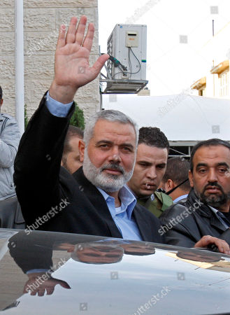 Ismail Haniyeh Gaza's Hamas Prime Minister Ismail Haniyeh waves to the crowd following a meeting with Egyptian Prime Minister Hesham Kandil, not seen, in Gaza City, . Israel offered to suspend its offensive in the Gaza Strip on Friday during a brief visit by Egypt's premier there if militants refrain from firing rockets at Israel, an official said, but the Palestinians unleashed a fresh salvo