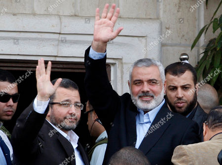 Hesham Kandil, Ismail Haniyeh Gaza's Hamas Prime Minister Ismail Haniyeh, right, and Egyptian Prime Minister Hesham Kandil, left, wave to the crowd as they meet in Gaza City, . Israel offered to suspend its offensive in the Gaza Strip on Friday during a brief visit by Egypt's premier there if militants refrain from firing rockets at Israel, an official said, but the Palestinians unleashed a fresh salvo