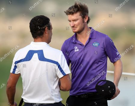 Chris Wood, Simon Khan Chris Wood of England, right, is congratulated by Simon Khan of England during the final round of the Commercial Bank Qatar Masters at the Doha Golf Club on