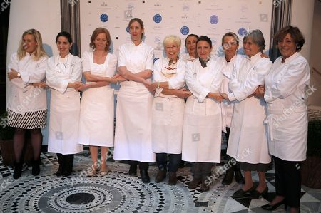 Alain Ducasse Left to right, Helene Darroze, Elena Arzak Espina, Johanna Maier, Clare Smyth, Giuseppina Beglia, Nicole Rubi, Anne Sophie Pic, Angels Serra Santamaria, Nadia Santini and Josy Bandecchi pose during the 25th anniversary of French chef Alain Ducasse's restaurant Le Louis XV, in Monaco. Alain Ducasse aspired to invite the greatest chefs.Thus, 240 chefs from 25 countries, representing 5 continents and 300 stars from the Michelin Guide meet in Monaco, for an unprecedented assembly