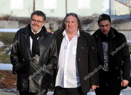 Stock Photo of French actor Gerard Depardieu, center, Montenegro Culture Minister Branislav Micunovic, left and city mayor Aleksandar Bogdanovic seen in Cetinje, the ancient capital of the republic, some 30km south of Podgorica, Montenegro, . Gerard Depardieu met with Russian President Vladimir Putin to get citizenship, got prime seats at soccer's biggest award ceremony in Switzerland, and dashed off to Montenegro for a look at real estate. But in three days of whirlwind travel, he didn't manage to show up at a Paris court hearing Tuesday to face drunken driving charges because, his lawyer said, he had a vital meeting abroad on an upcoming film. He was in Montenegro meeting with the prime minister, it turns out
