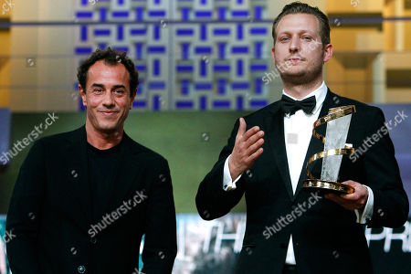 "Tobias Lindholm, Matteo Garrone Italian director Matteo Garrone, left, and Danish film director Tobias Lindholm pose for photographers after Lindholm received the Best Male Performance award for his film ""A Hijacking"" during the 12th Marrakech International Film Festival in Marrakech, Morocco"