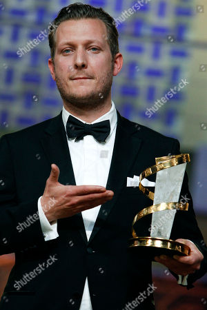 "Tobias Lindholm Danish film director Tobias Lindholm poses for photographers after receiving the Best Male Performance award for his film ""A Hijacking"" during the 12th Marrakech International Film Festival in Marrakech, Morocco"