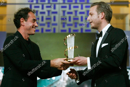 "Tobias Lindholm, Matteo Garrone Italian director Matteo Garrone, left, gives the Golden Star award for the Best Male Performance to Danish film director Tobias Lindholm, for his film ""A Hijacking"" during the 12th Marrakech International Film Festival in Marrakech, Morocco"