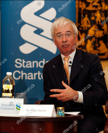 Peter Sands, group chief executive of Standard Chartered, talks to the media during a press conference of reopening their representative office in Myanmar, at a hotel in Yangon, Myanmar