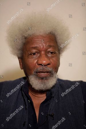 """Nobel Laureate Wole Soyinka, speaks to foreign journalist during an interview in Lagos, Nigeria, . Soyinka said Friday his home of Nigeria is """"at war"""" with the radical Islamist sect known as Boko Haram, dismissing calls for peace negotiations he believes only will lead to an """"abysmal appeasement."""" The comments from the 78-year-old playwright and essayist come as Nigeria's northeast remains under almost daily attack by the sect, which is blamed for killing more than 740 people this year alone, according to an Associated Press count. Three police officers died in an apparent bombing carried out by the sect in Yobe state early Friday morning, officials said"""