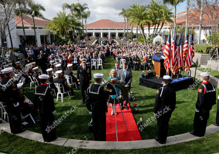 Stock Picture of Tricia Nixon Cox daughter of the 37th U.S. President Richard M. Nixon stands in front of a wreath honoring her father during a commemoration of the 100th anniversary of the birth of Richard Nixon at the Richard Nixon Presidential Library in Yorba Linda, Calif