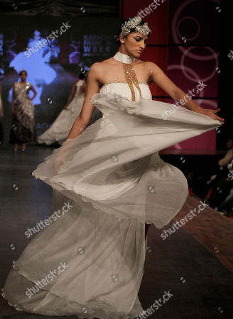 A Pakistani model presents a creation by designer Rizwan Ahmed on the last day of Karachi Fashion Week, in Karachi, Pakistan