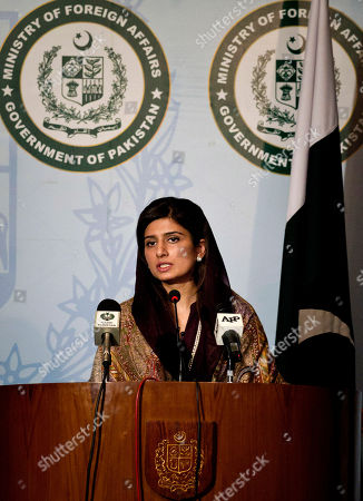 "Pakistan's Foreign Minister Hina Rabbani Khar speaks during a press conference in Islamabad, Pakistan, . Khar said that she hoped the recent incidents would not derail the process of improving relations between the India and Pakistan. She told reporters that she wants to continue down the track of ""trust building"" and ""normalizing the region, which has been very unstable because of irresponsible actions and statements"