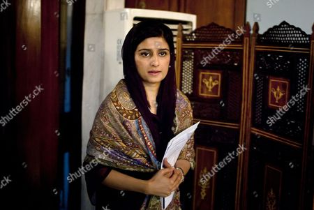 "Pakistan's Foreign Minister Hina Rabbani Khar arrives to speak at a press conference in Islamabad, Pakistan, . Khar said that she hoped the recent incidents would not derail the process of improving relations between the India and Pakistan. She told reporters that she wants to continue down the track of ""trust building"" and ""normalizing the region, which has been very unstable because of irresponsible actions and statements"