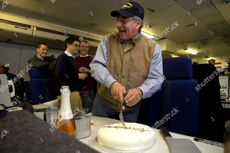 "Leon Panetta The traveling staff on board the E-4B surprise U.S. Defense Secretary Leon Panetta with a cake that says ""arrivederci,"" in a celebration in honor of the last leg of his final overseas trip as secretary, en route to Washington on . The plastic meat axe at right was a joke gift from the staff, at the secretary's reference to budget sequestration being a meat axe"