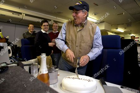"Stock Photo of Leon Panetta The traveling staff on board the E-4B surprise U.S. Defense Secretary Leon Panetta with a cake that says ""arrivederci,"" in a celebration in honor of the last leg of his final overseas trip as secretary, en route to Washington, . The plastic meat axe at right was a joke gift from the staff, at the secretary's reference to budget sequestration being a meat axe"
