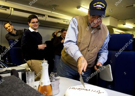 "Leon Panetta The traveling staff on board the E-4B surprise U.S. Defense Secretary Leon Panetta with a cake that says ""arrivederci,"" in a celebration in honor of the last leg of his final overseas trip as secretary, en route to Washington, . The plastic meat axe at right was a joke gift from the staff, at the secretary's reference to budget sequestration being a meat axe"