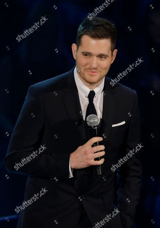 """Michael Buble Canadian singer Michael Buble' performs during the Italian State RAI TV program """"Che Tempo che Fa"""", in Milan, Italy. Most of Buble's albums have reached multiplatinum status and his last three releases have hit No. 1 on the Billboard 200 albums chart, including 2011's triple platinum """"Christmas."""" His new album, """"To Be Loved,"""" will be released April 23 and includes a tribute to his wife, Argentine TV actress Luisana Lopilato"""