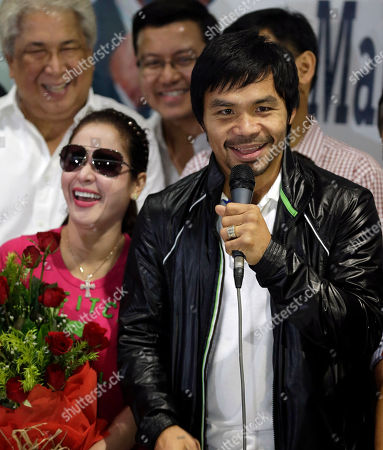 "Manny Pacquiao, Jinkee Pacquiao Filipino boxer Manny Pacquiao, right, cracks a joke as he addresses his fans upon arrival in Manila, Philippines with his wife, Jinkee, left, following his 6th round knockout loss to Mexican Juan Manuel Marquez in Las Vegas, Nevada. In his live broadcast at the airport, Pacquiao assured fans ""we will rise again"
