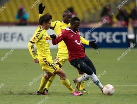 Yuri Zhirkov, Lassana Diarra, Didier Ya Konan Anzhi'sYuri Zhirkov, left, Lassana Diarra, and Hannover 96's Didier Ya Konan struggle for the ball during their Europa League round of 32 soccer match, at Luzhniki stadium in Moscow, Russia, on