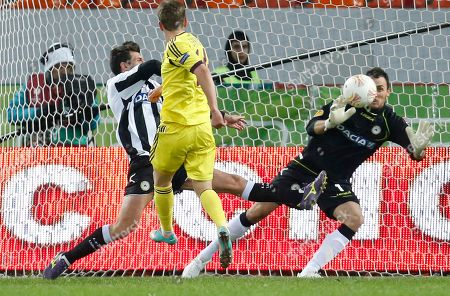 Vladimir Gabulov, Oleg Shatov, Maurizio Domizzi Udinese's Maurizio Domizzi, left, tryes to score against Anzhi's goalkeeper Vladimir Gabulov and Oleg Shatov, center, during their Europa league group A soccer match in Moscow, Russia