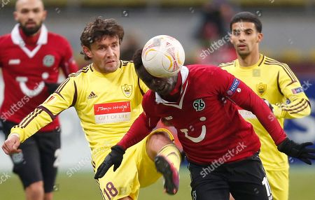 Yuri Zhirkov, Didier Ya Konan Hannover's Didier Ya Konan, right, in close action with Anji's Yuri Zhirkov during their Europa league, round of 32, first leg soccer match in Moscow, Russia